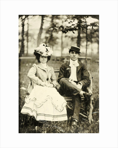 Portrait of a man and woman sitting on a bench in a forest or park setting by Anonymous