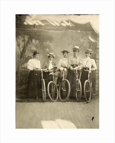 Group portrait of five women with bikes for a painted backdrop with forest by Anonymous