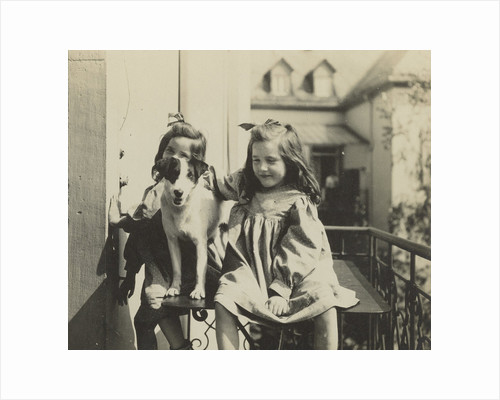 Two girls and a dog on a balcony at the rear of a house by Anonymous