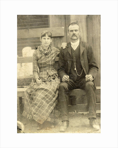 Portrait of a man and a woman sitting on a bench in front of their house (?) by Anonymous