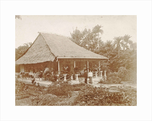 Man and woman posing for a house with a garden in Ambon, Indonesia by Anonymous