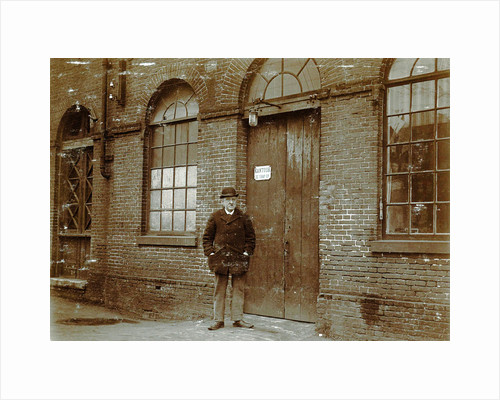 Man standing in front of an office door by Anonymous