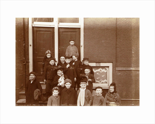 Group of children posing on stairs for entrance doors by Anonymous
