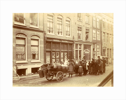 Children and adults watch the work for a liquor store and waffle bakery Jac. van der Zee by Anonymous