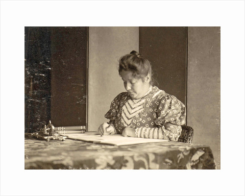 woman writing at a table by Anonymous