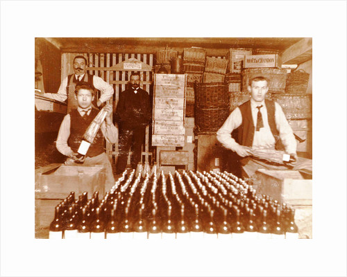 Men packaged bottled beverage bottles in crates by Anonymous