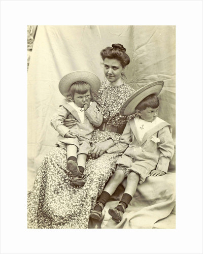 Portrait of a woman with two children with sun hats and sailor suits by Anonymous