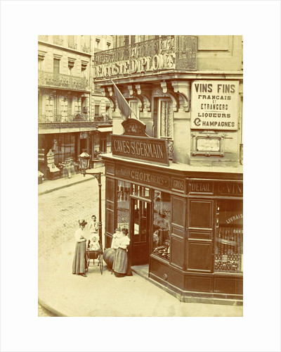 Two women and three children standing at the entrance of wine trade Caves St. Germain by Anonymous