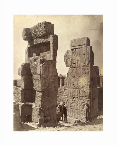 Three men posing with a relief of King Darius at Persepolis by Antoine Sevruguin