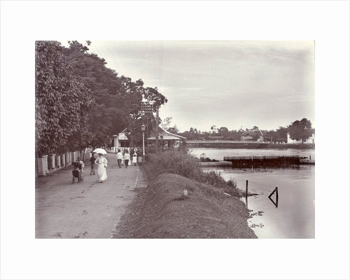 Hikers on a riverbank in Surabaya and in the background the Goebengbrug, Indonesia by Anonymous