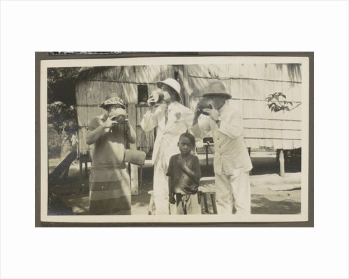 Two men in tropical clothing and a woman drinking from bowls, leading a boy by Anonymous
