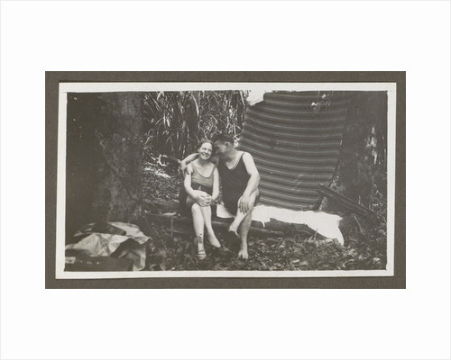 Man and a woman in swimwear on a bench in a forest by Anonymous