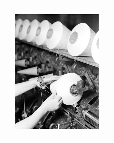 High Point, North Carolina - Textiles. Pickett Yarn Mill. Winder operator by Lewis Hine