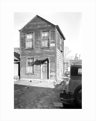 Paterson, New Jersey - Textiles. Two-room home, (kitchen below, bedroom above) of an old retired silk-worker by Lewis Hine