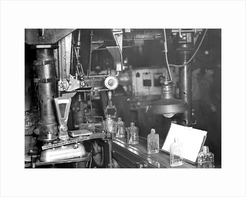 Millville, New Jersey - Glass bottles. Bottles moving along a conveyor belt, 1936 by Lewis Hine
