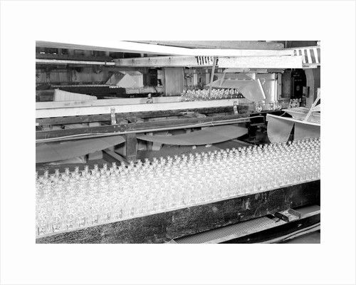 Millville, New Jersey - Glass bottles. Numerous bottles in foreground and bottles on a conveyor belt, 1936 by Lewis Hine