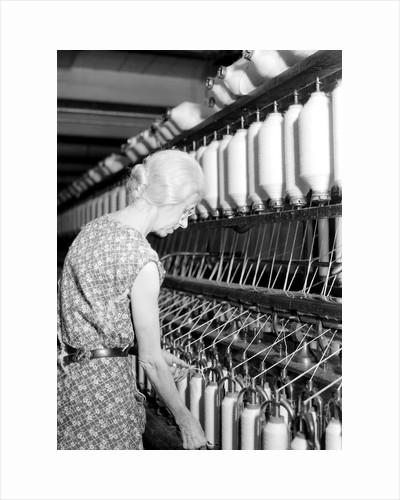 Millville, New Jersey - Textiles. Millville Manufacturing Co. Lady twisting thread, 1936 by Lewis Hine