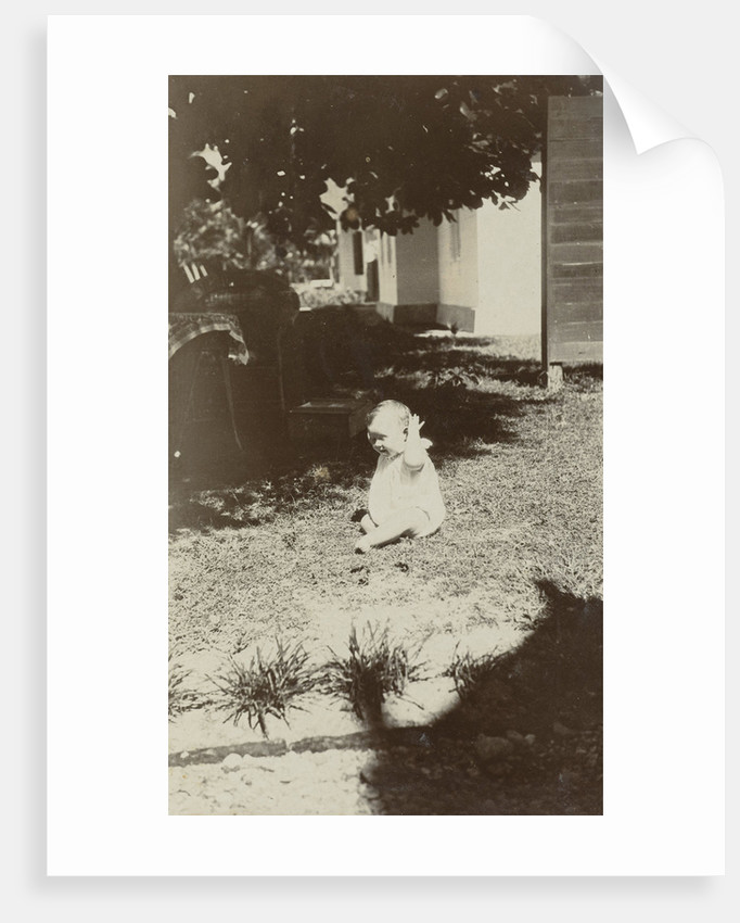 Child in the grass by Anonymous