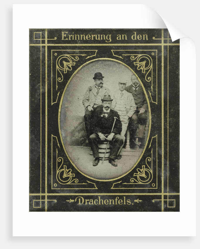 Portrait of four men standing and sitting on a ton and a balustrade, Drachenfels, Germany by Anonymous