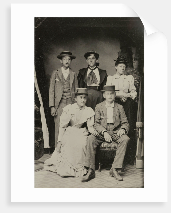 Group portrait of two men and three women, standing and sitting in a cramped studio by Anonymous
