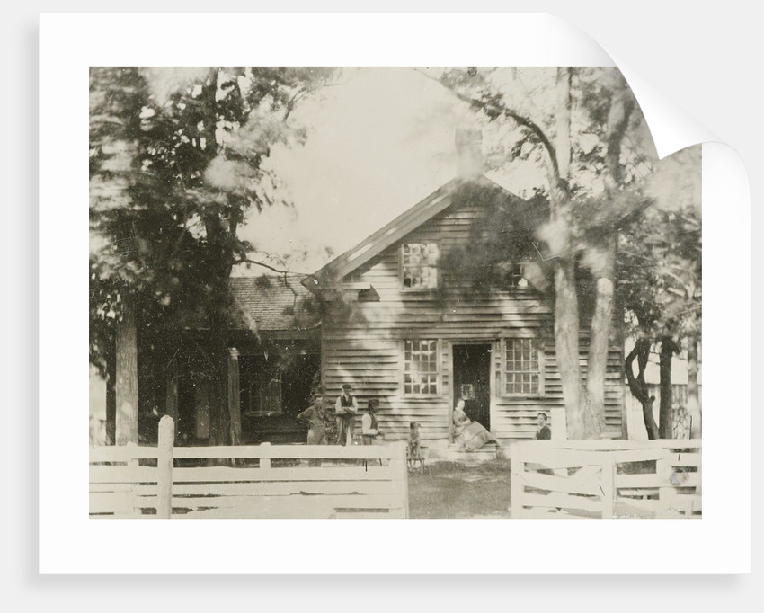 View of a wooden house, with five people and a dog by Anonymous