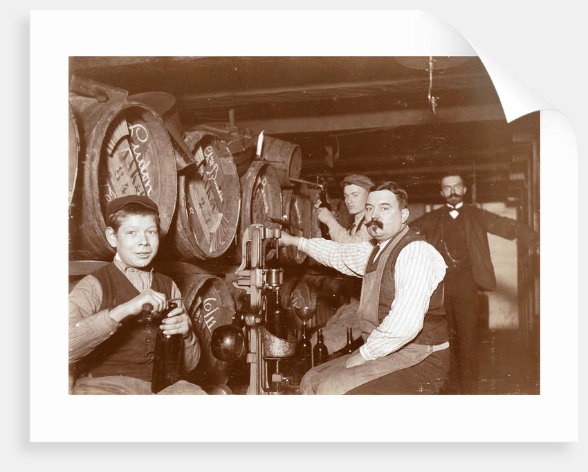 Brouwer and clerks in wine barrels and a corking machine by Anonymous
