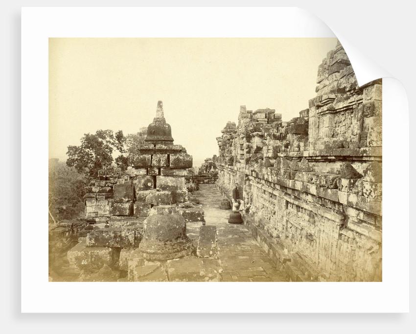 Indian man on a relationship of Borobudur in Java, Indonesia by Anonymous