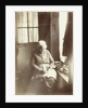 Old woman sitting by a window sewing by Anonymous