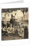 Group portrait of nine boys and a dog, standing and sitting in the open air by Anonymous