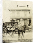 Three women and a girl (?) In a carriage with horse, with a backdrop of a wooden house by Anonymous