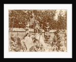 Group of wooden sculptures in the open air in the Dutch East Indies, Indonesia by Anonymous