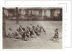 Javanese men sitting on the ground in a craton, Indonesia by Anonymous