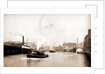 Chicago River scene with steamboat and industrial waterfront by Anonymous