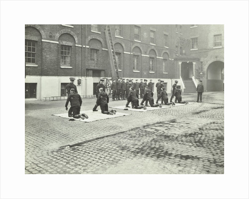 Demonstrating how to pick up an unconscious person, London Fire Brigade Headquarters, London, 1910 by Unknown