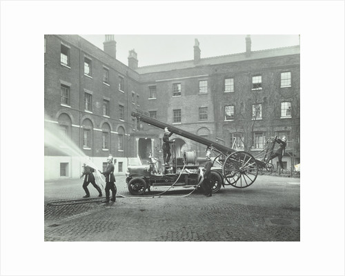 Fireman using a hose, London Fire Brigade Headquarters, London, 1910 by Unknown
