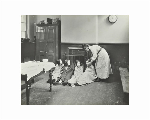 Girls drying their hair by the fire after a bath, Chaucer Cleansing Station, London, 1911 by Unknown