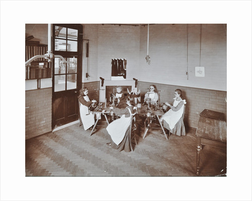 Girls knitting socks by machine at the Elm Lodge School for Blind Girls, London, 1908 by Unknown