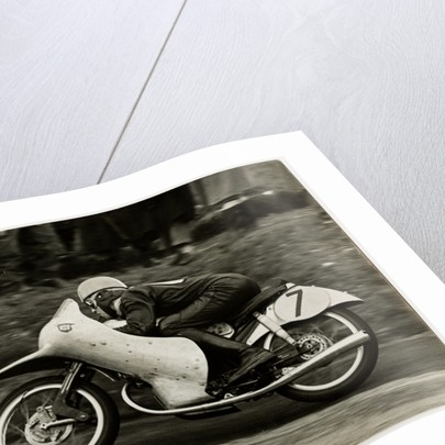 Werner Haas, riding NSU (number 7) 1954 TT (Tourist Trophy) by T.M. Badger