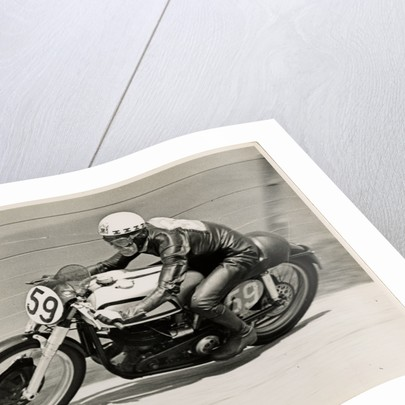 Ray Amm, TT (Tourist Trophy) rider, riding a Norton (number 59) by T.M. Badger
