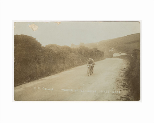 Rider passing along Kirk Michael to Peel coast road, captioned 'C.R.Collier, winner of the motorcycle race', likely to be 1907 TT (Tourist Trophy) by Anonymous