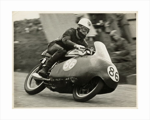 John Hartle, riding a Norton (number 86), 1957 Junior TT (Tourist Trophy) by T.M. Badger