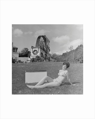 Woman in bikini advertising portable electric heater, Laxey Wheel by Manx Press Pictures