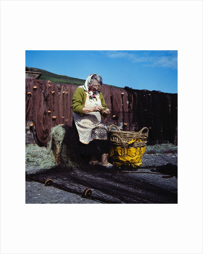 Mending the nets by Manx Press Pictures