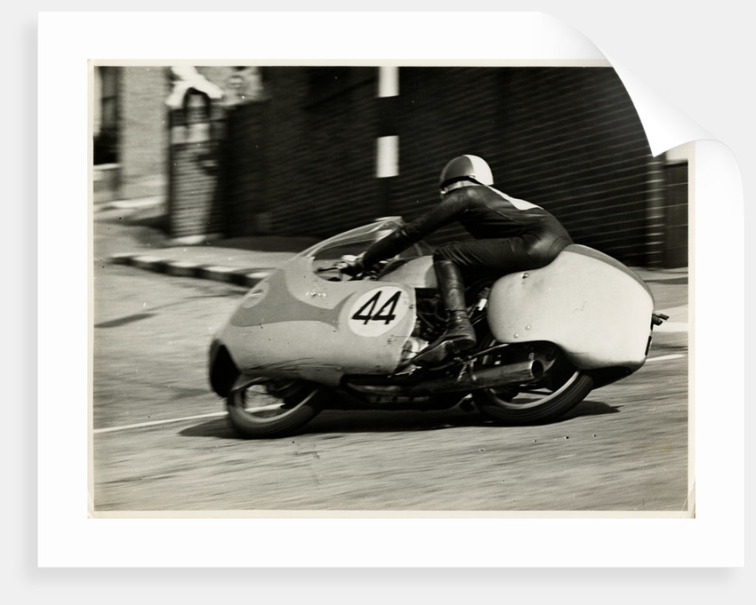 TT (Tourist Trophy) rider number 44, cornering at the Manx Arms (?) by T.M. Badger