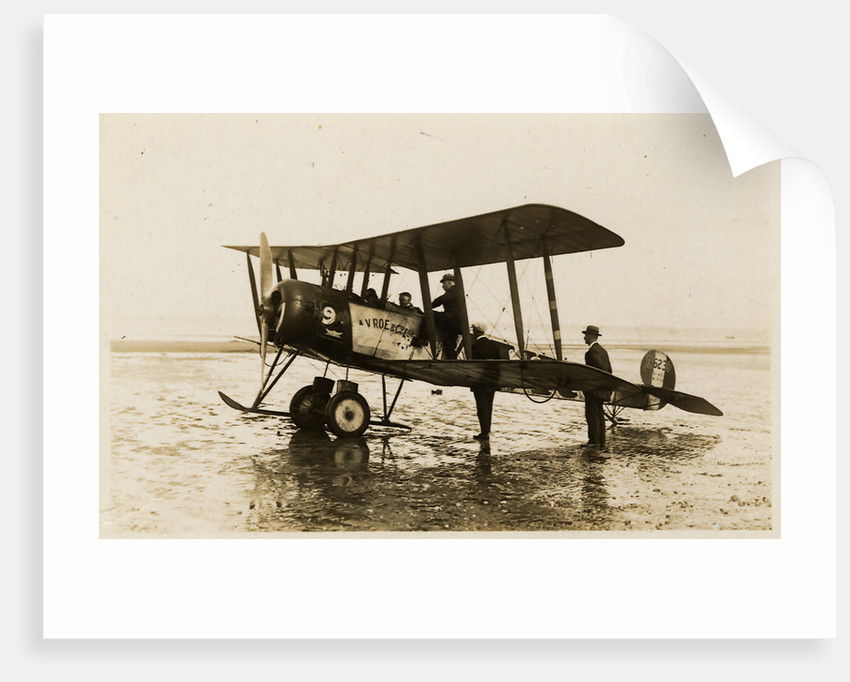 Plane No. 9 on the shore at Ramsey belonging to A.V. Roe and Co. Ltd. G.W. Kewin, town surveyor climbing into the cockpit by Thomas Horsfell Midwood