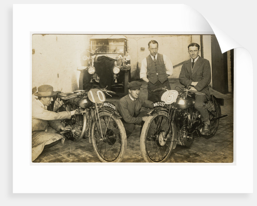 Tom Sheard, TT (Tourist Trophy) rider poses with machine number 13 (registration MN3297) in a garage with mechanics by Thomas Horsfell Midwood
