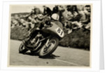 John Surtees riding as number 81 at Kate's Cottage, 1956 Senior TT (Tourist Trophy) by T.M. Badger