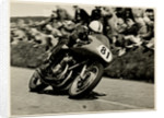 John Surtees, riding as number 81, 1956 TT (Tourist Trophy) by T.M. Badger