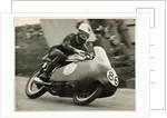 John Hartle, riding a Norton (number 86), 1957 Junior TT (Tourist Trophy) by T.M. Badger