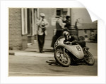 Fron Purslow, aboard 124cc Ducati (number 18), 1958 125 TT (Tourist Trophy) by T.M. Badger